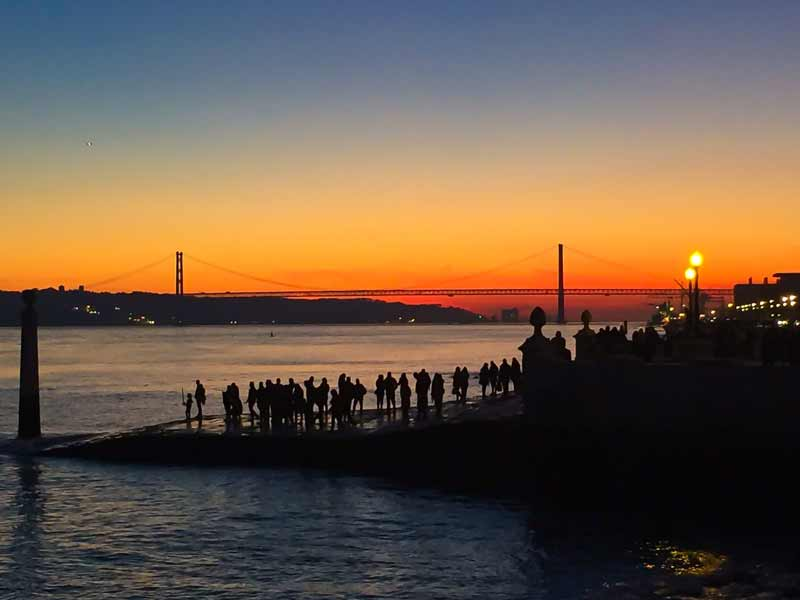 Watch the sunset in Lisbon