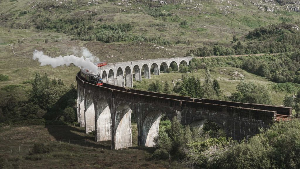 The Harry Potter train running over the Glenfinnan viaduct in Scotland