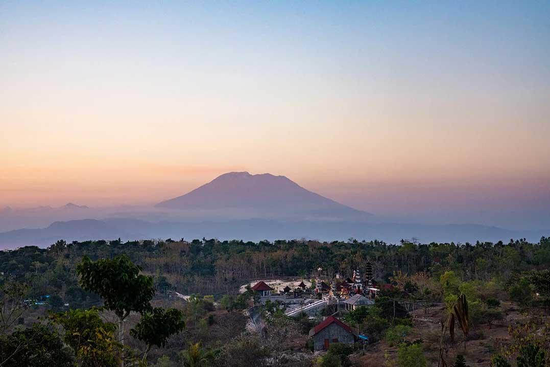 """Sunset from """"kitchen steak"""" over Mount Agung, Nusa Penida"""