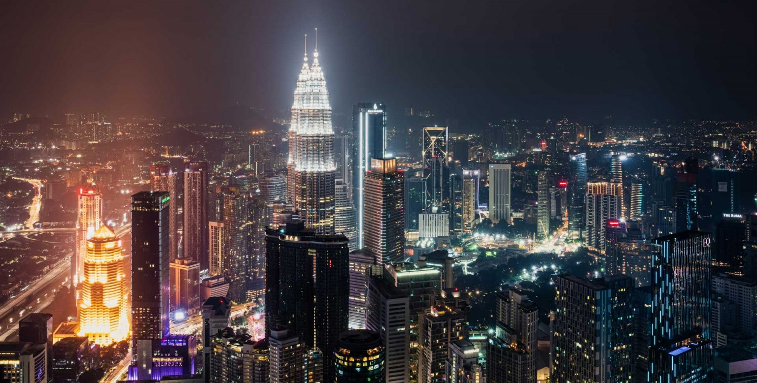 City scape at night - Petronas Towers in Kuala Lumpur, Malaysia