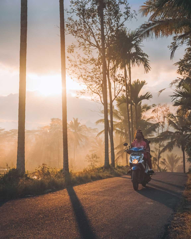 Locals at sunrise in Tampaksilling - Bali